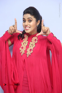 Actress Poorna Latest Stills in Red Dress at Rakshasi First Look Launch  0101.JPG