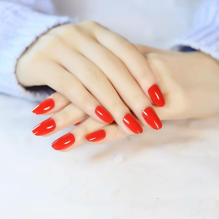 Red Nail Polish On Thumb: Round Red Nails