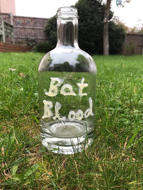 step by step spooky bottle 'Bats Blood' DIY Halloween crafts