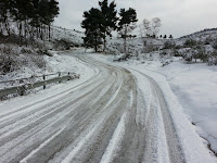 Picture of a snow and ice covered road.