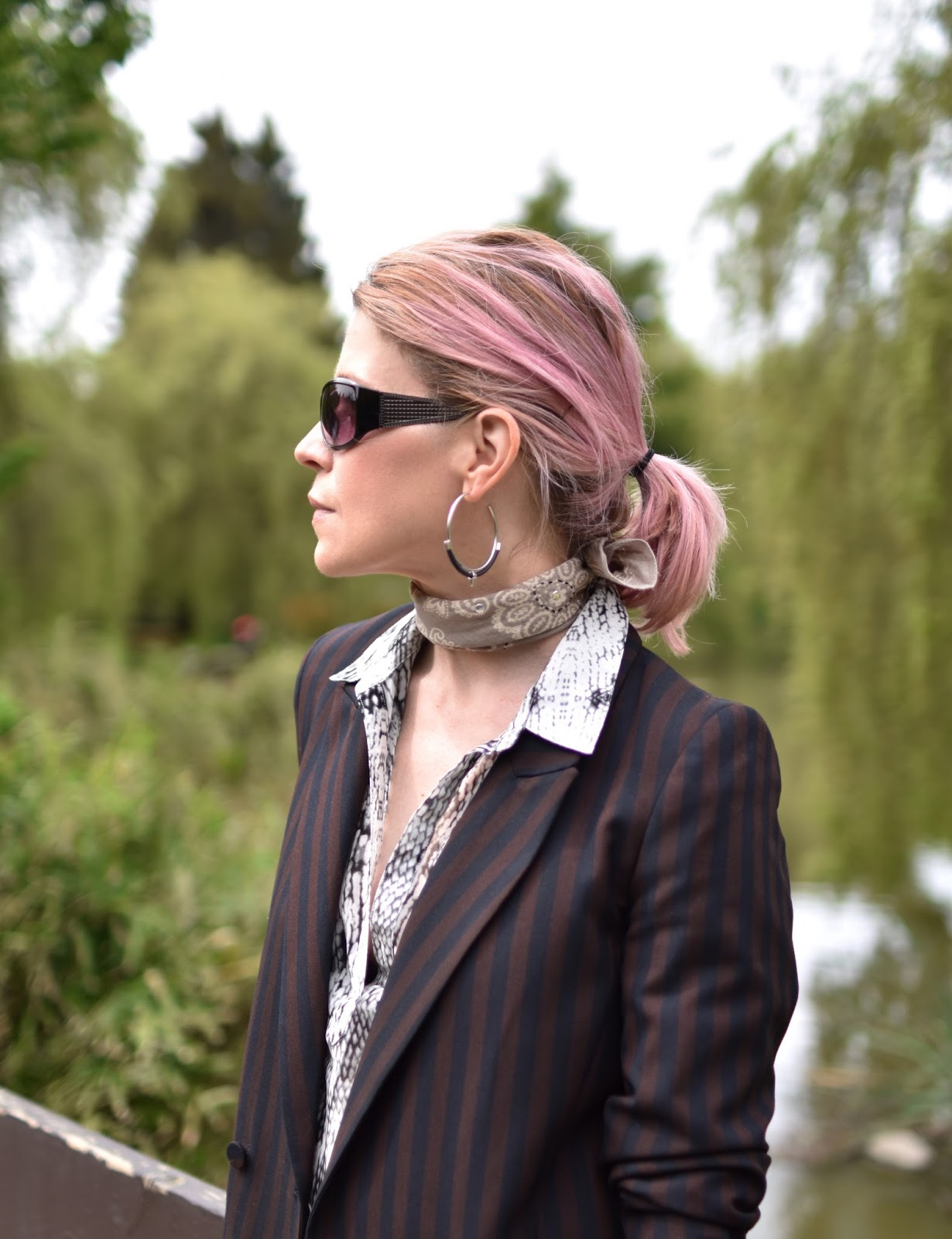Monika Faulkner outfit inspiration - slouchy suit jacket, snake-patterned blouse, bandana, sunglasses