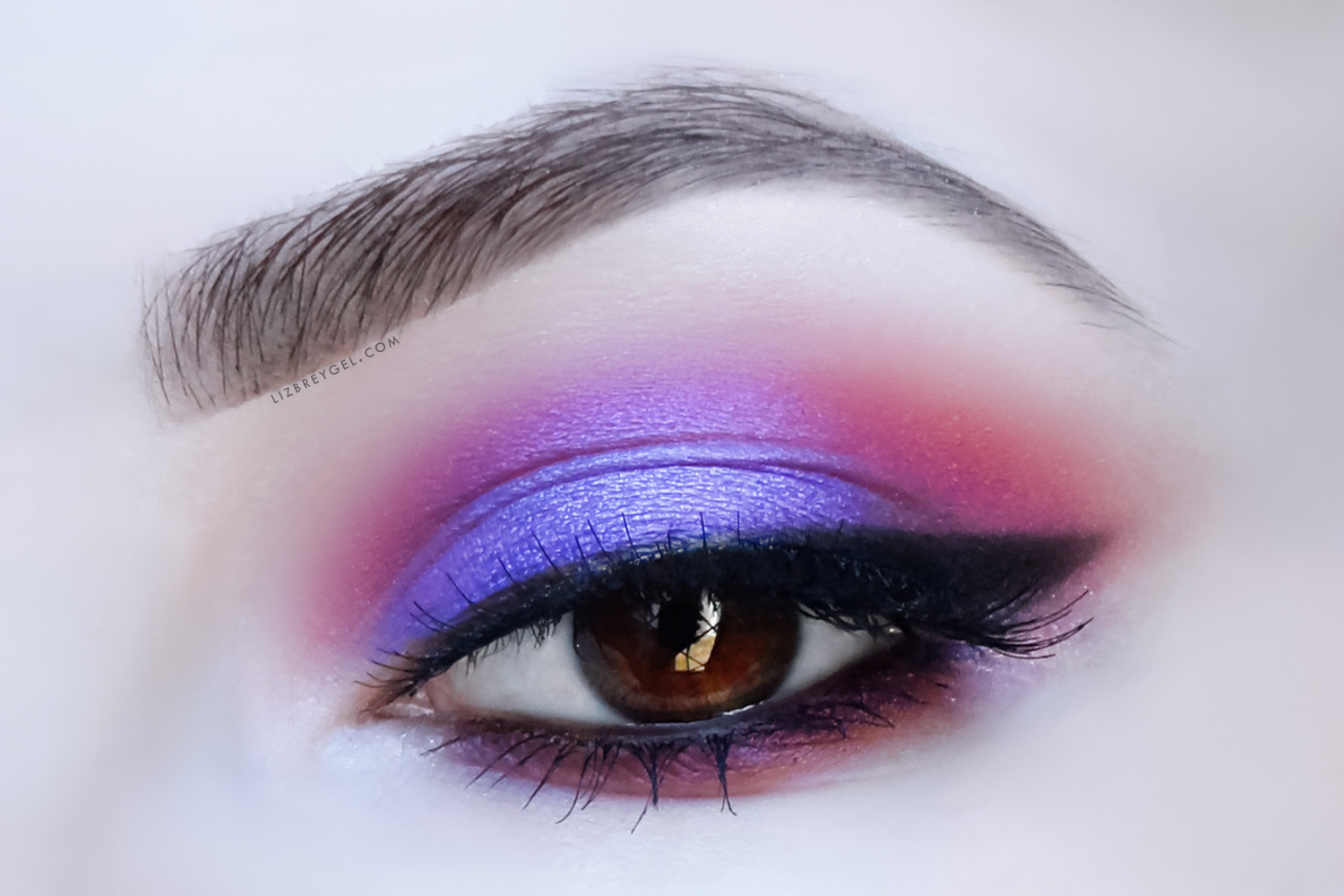 a close up picture of an eye with a dramatic smokey eye makeup look