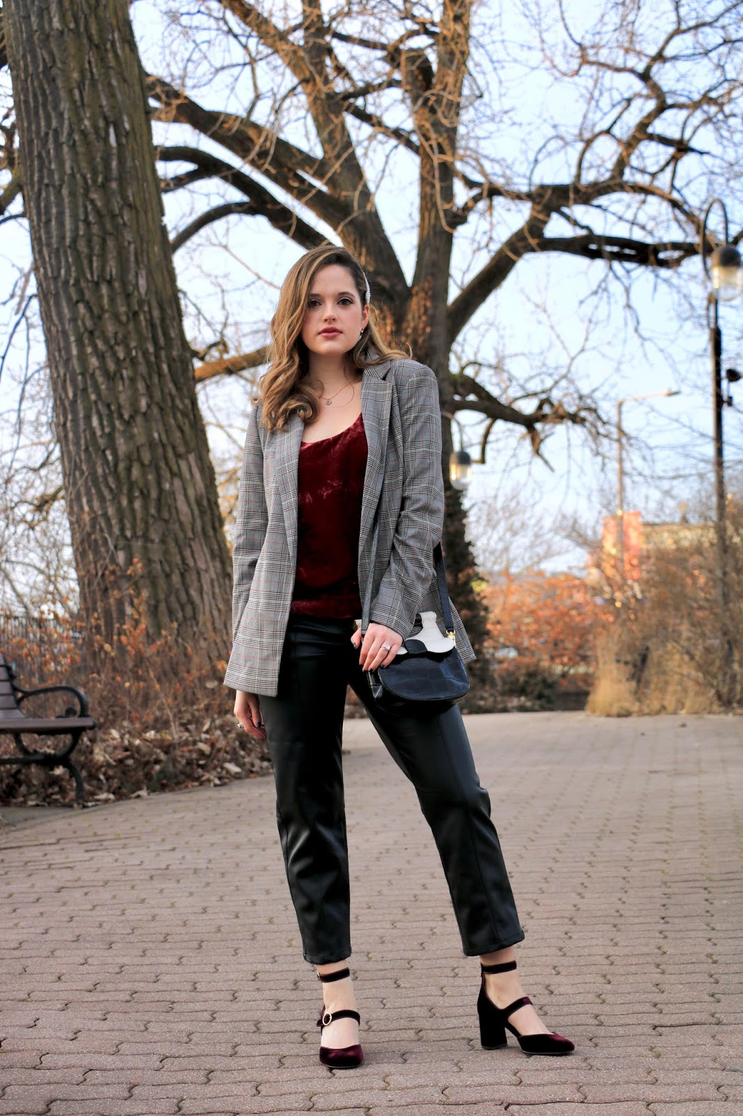 Nyc fashion blogger Kathleen Harper wearing an outfit with leather pants.