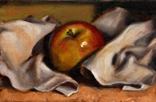 Oil painting of an apple nestled amongst the folds of a tea towel.