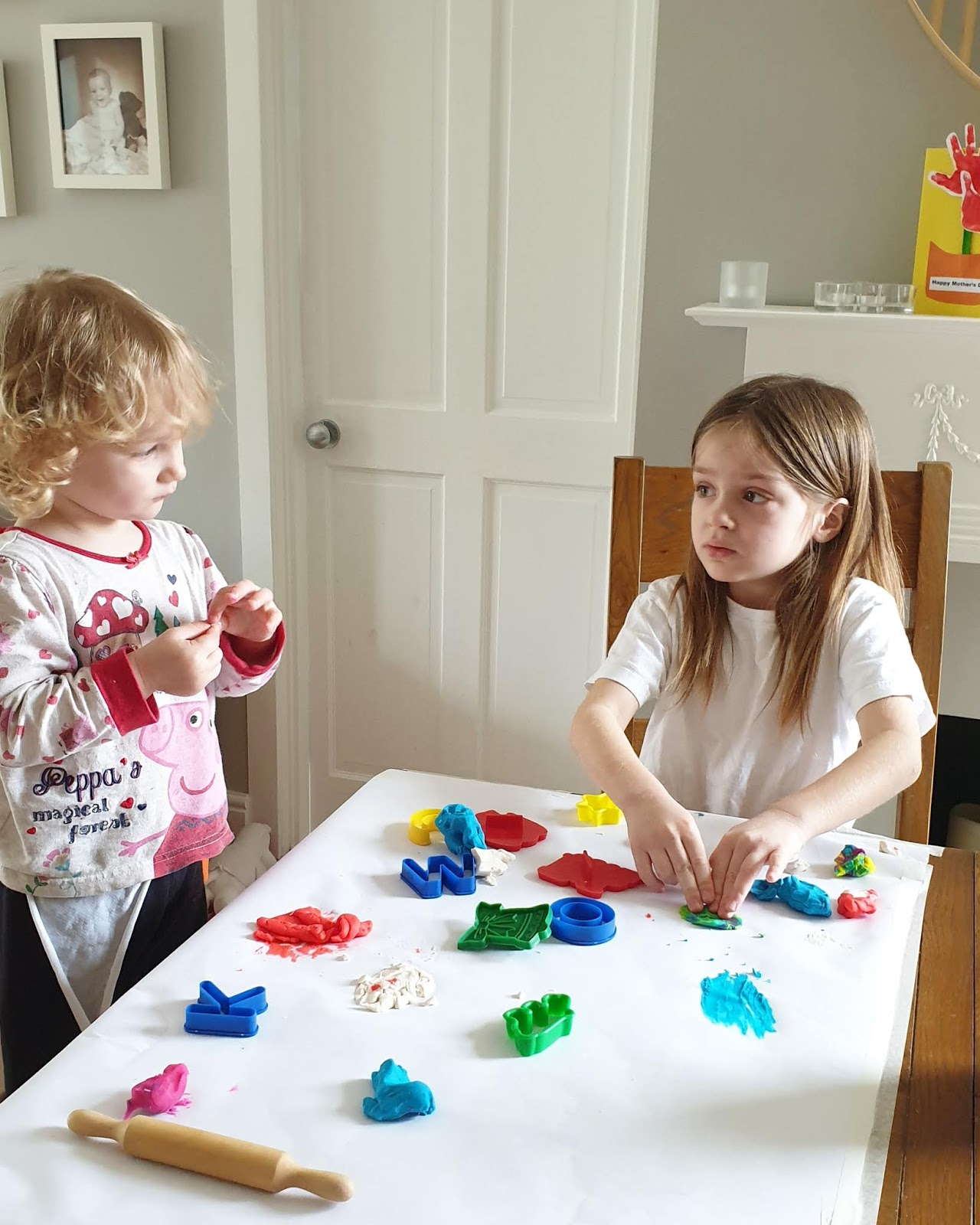 sisters playing with play doh