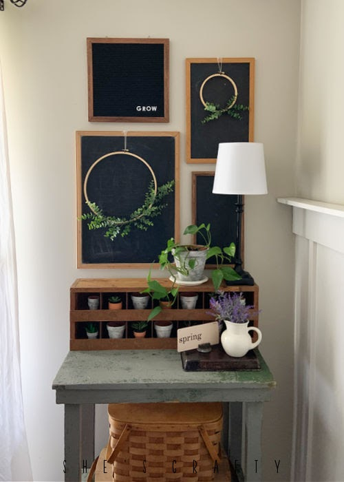 Spring Home Tour - living room with chalkboard gallery wall.