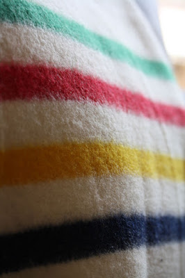 An easy DiY Hudson's Bay Co HBC Point Blanket Quilt featuring traditional pattern front with pixelated stripes, blue single color point blanket backing (making the quilt fully reversible), all pieced with Aurifil thread! By Erin D. of Sew at Home Mummy