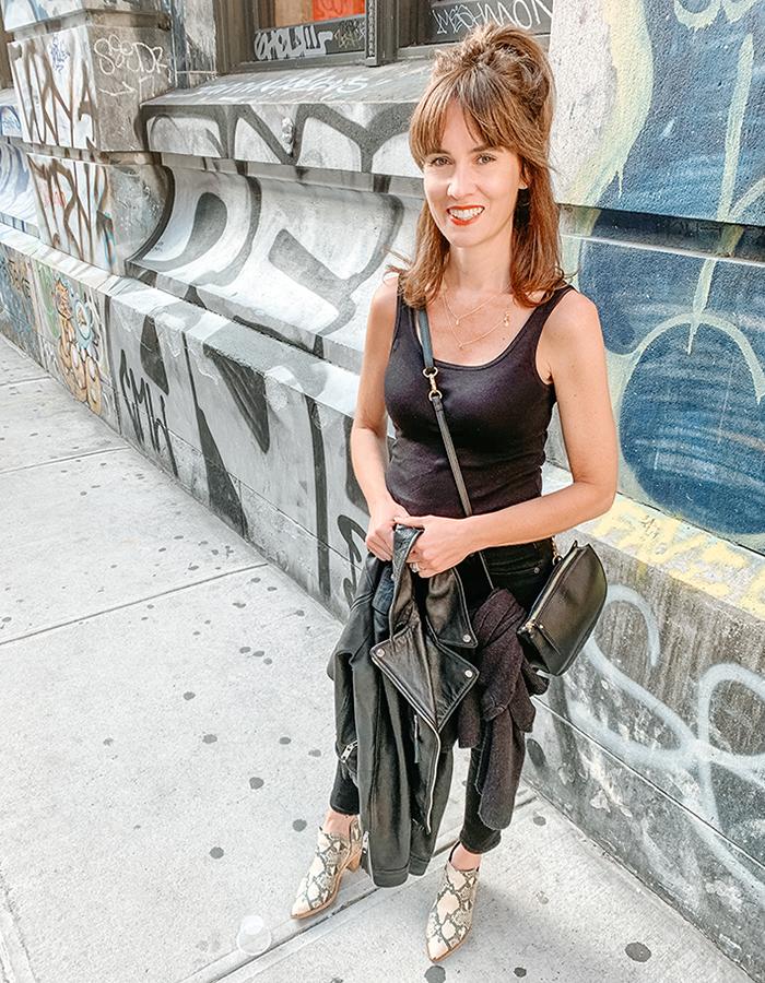 NYC street style black jeans black tank snake booties