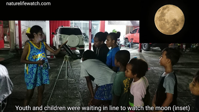 some youth and children in Manokwari city were watching the full moon