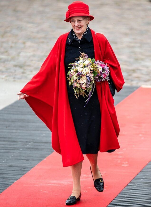 Queen Margrethe wore a red wool cape and hat. Crown Princess Mary