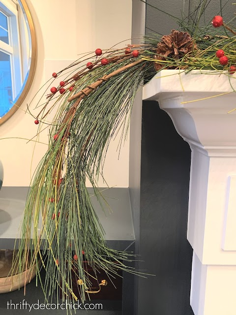 berries and garland on mantel