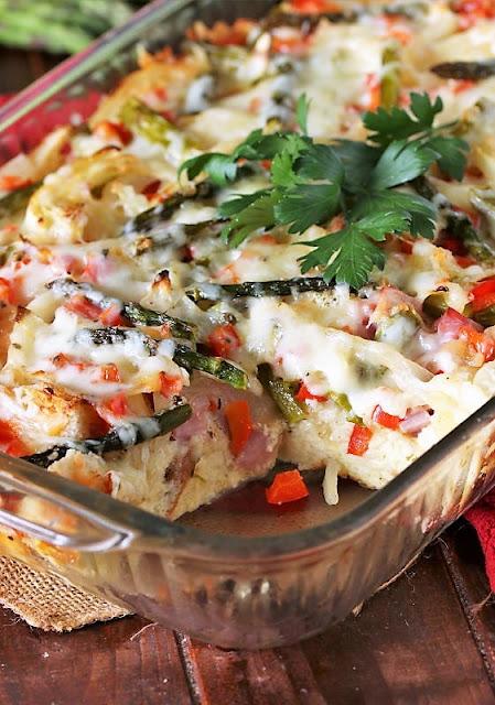 Serving Overnight Asparagus Breakfast Casserole with Ham Image