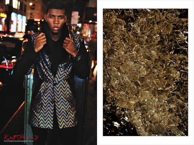 Night shot, man's chevron coat on the stree, mid shot. Image paired with amber ice on road. Menswear photographed in New York City by Kent Johnson.
