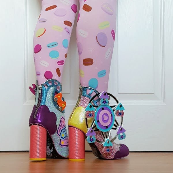 centre back zip up ankle boots with fun and games detailing on them