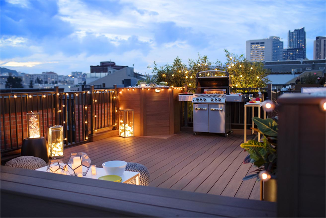Outdoor dining on rooftop deck BBQ