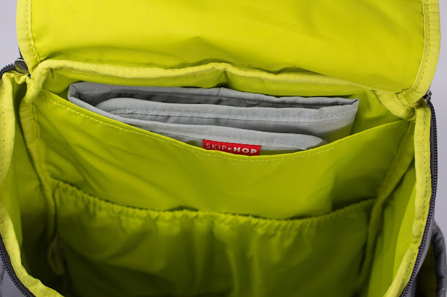 Close up view of main compartment showing the elasticated pockets and changing mat