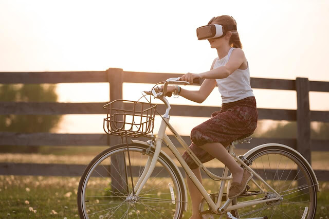 Augmented Reality girl on bicycle