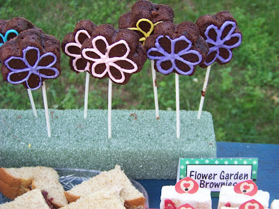 Brownie Flower Pops from our Alice in Wonderland Birthday Party. Celebrate with us and this fun Alice in Wonderland Birthday party.  With all the DIYs, printables, decorations, favors, and fun, you can recreate any part of this birthday party and go down the rabbit hole to Wonderland anytime.