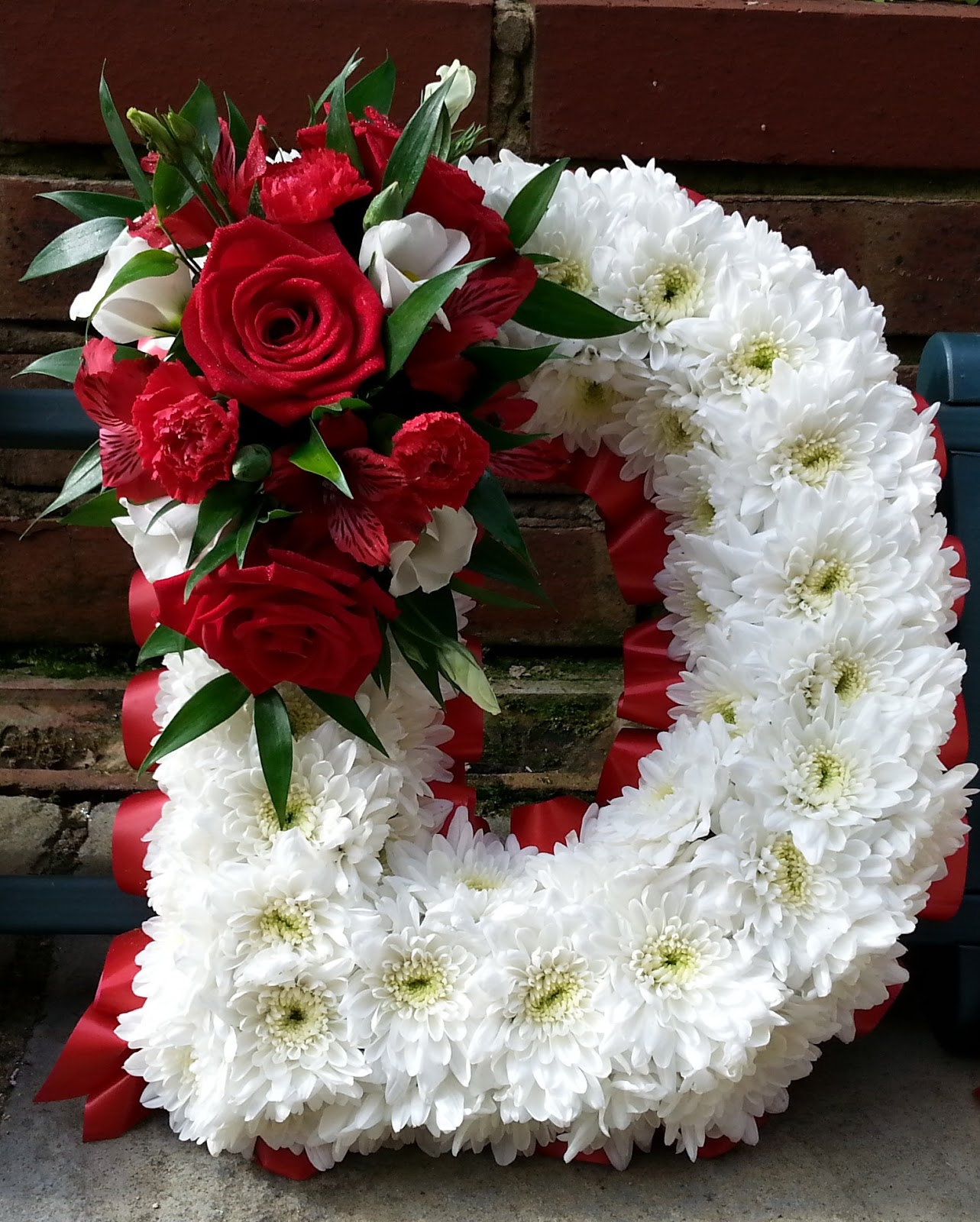 Maria bellissima flowers grandad funeral arrangement letters last of all i filled in the gaps using red spray carnations red alstreomeria and white lisianthus to break up all the red flowers izmirmasajfo
