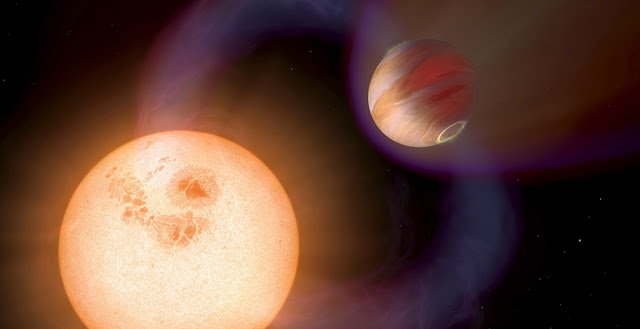 This illustration shows a hot Jupiter orbiting so close to a red dwarf star that the magnetic fields of both interact, triggering activity on the star. Astrophysicists have for the first time used observations of such activity to calculate field strengths in four hot Jupiter star-and-planet systems. Image credit: NASA, ESA and A. Schaller (for STScI)