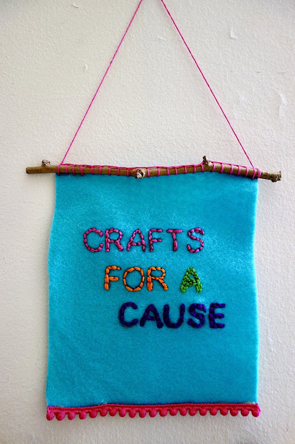 banner, felt banner, embroidery, embroidered letters, blah to TADA, pompom trim, twigs, handmade, crafts, sewing, sign, crafts for a cause, crafts to help others, passion project