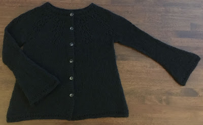 Black hand-knitted Nineveh cardigan laid out