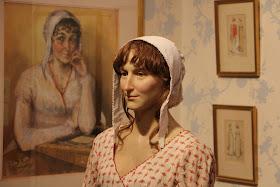 Portrait and waxwork of Jane Austen  on display at the Jane Austen Centre in Bath
