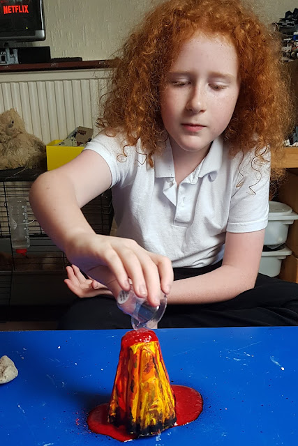 Adding water making Volcano erupt red liquid
