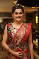 Tapsee Pannu Latest Stills in Red Silk Saree at Anando hma Pre Release Event .COM 0054.JPG