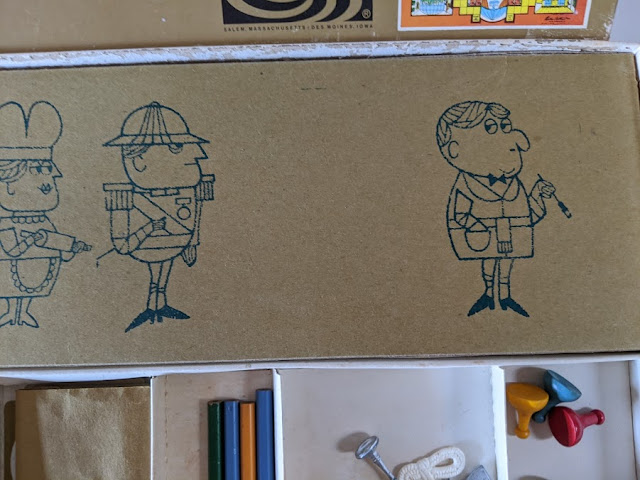 picture of cartoon drawings on a cardboard game box