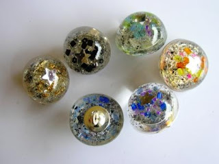 Custom made buttons containing ashes