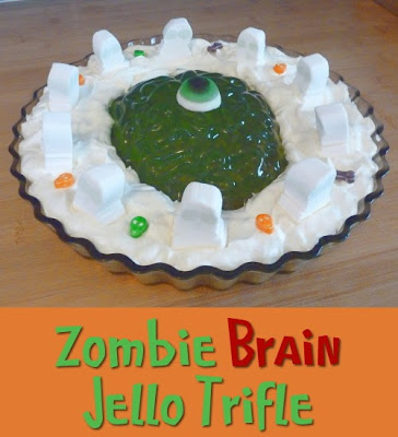 Green brain shaped Jello with whipped cream, custard and ghost candy