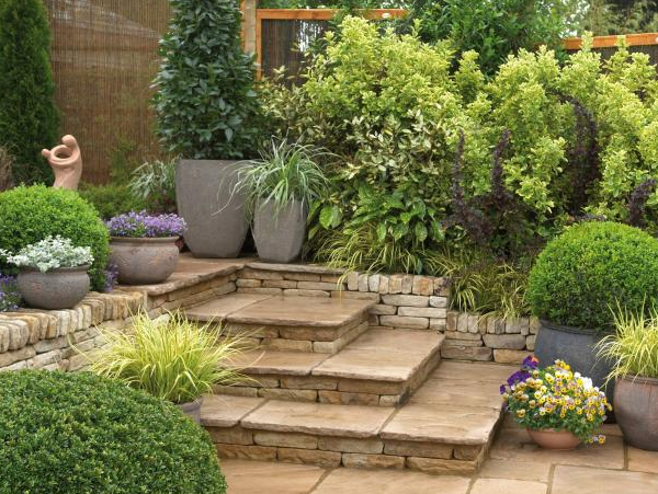 Gardens with many paved surfaces are lower maintenance than those with expanses of lawn. Container gardening takes less time and upkeep for limited time and space.