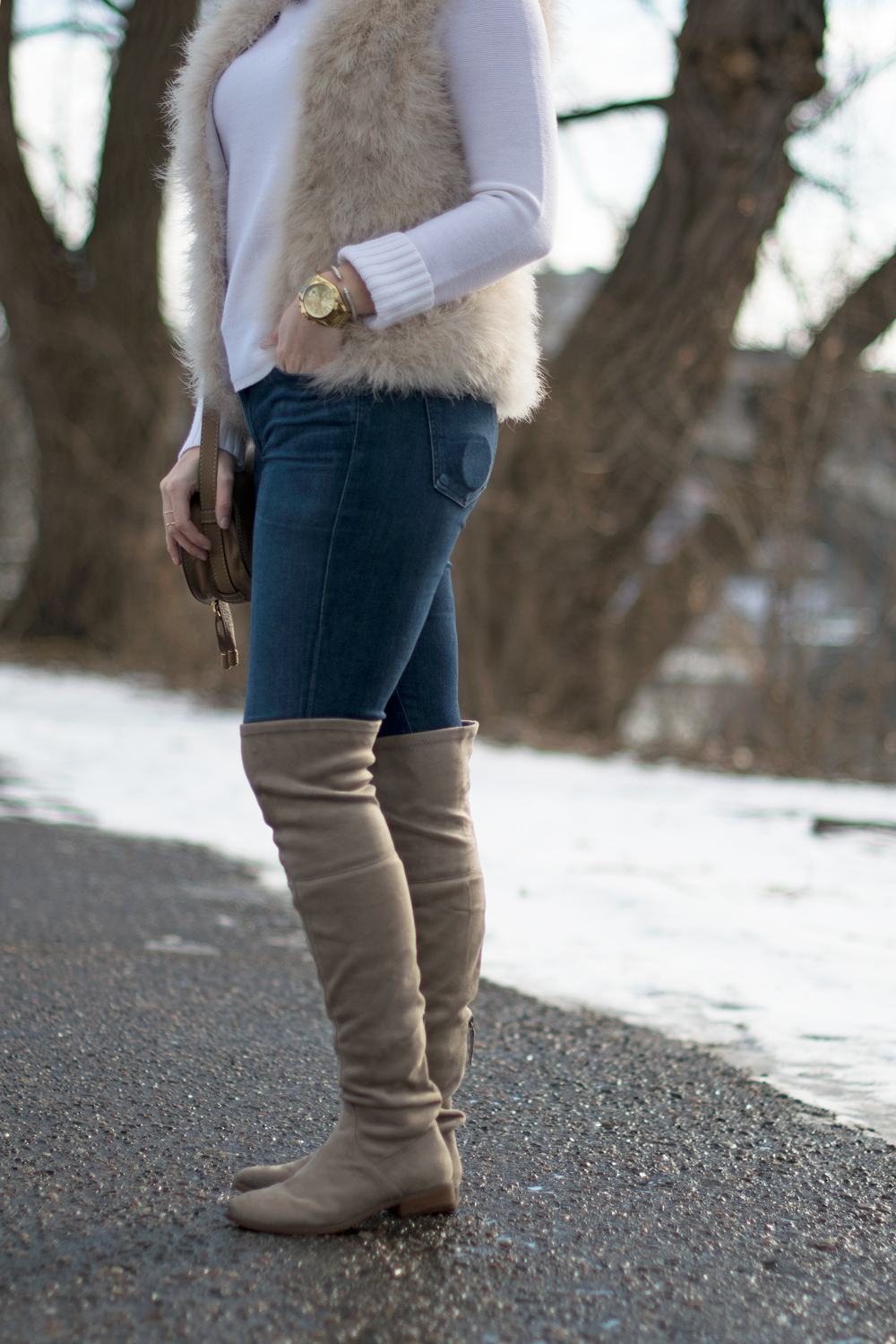 Taupe over the knee boot styling.
