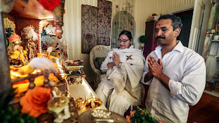 Kaveeta Bhavsaar, known to her followers as Sree Maa, and husband Sunil Kumar Porumamilla, known as Shri Ji, worship at a shrine in their Mission Bay, Auckland living room.