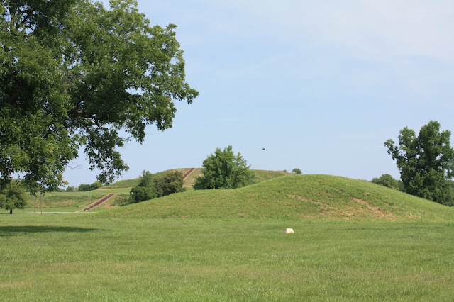 A mound with the larger Monk's Mound behind