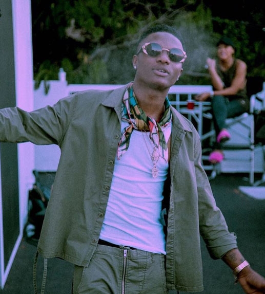 Wizkid swagged up as singer is pictured on music video set with girlfriend