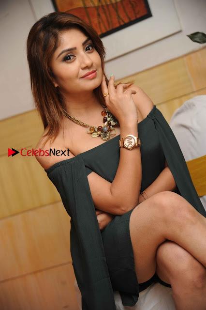 Kannada Actress Karunya Ram Stills in Strapless Green Short Dress at Eradu Kanasu Movie Press Meet  0002.jpg