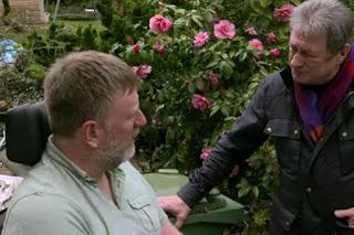 Alan speaks to Chris in the garden