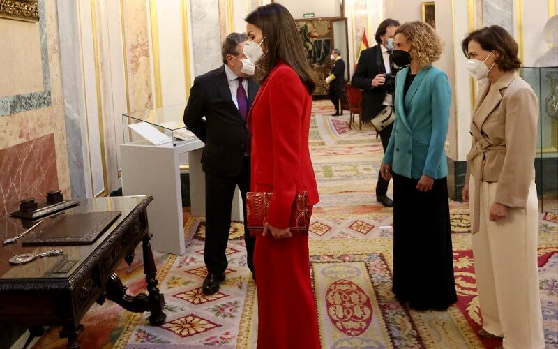 Queen Letizia wore a two-piece red suit by Spanish fashion designer Roberto Torretta