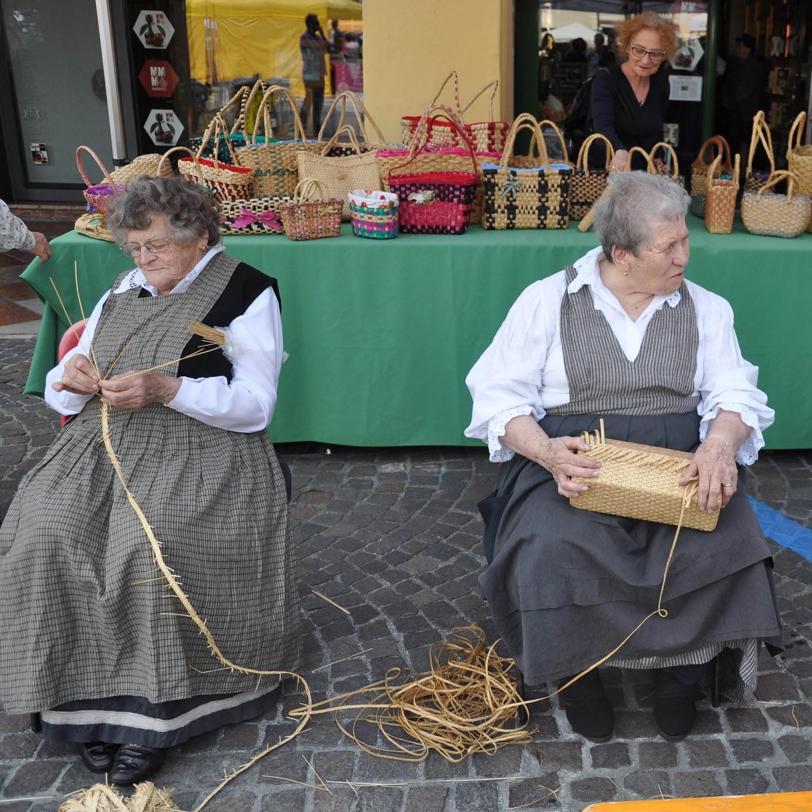 Old ladies weave bags, Cherry Show Market, Marostica, Veneto, Italy