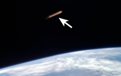 Huge Tube UFO Spotted In Earths Orbit?