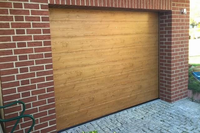 garagentore und hoftorantriebe berlin brandenburg h rmann sectionaltor winchester oak. Black Bedroom Furniture Sets. Home Design Ideas