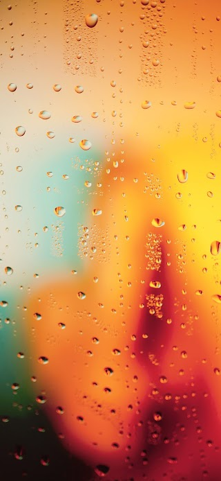 Water droplets on orange glass wallpaper