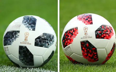 The World Cup balls - on the left, the version used in the group stages and on the right, the knockout edition