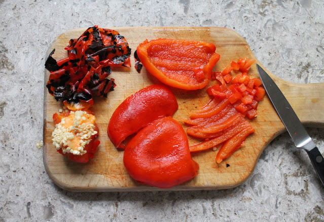 Chopping the red pepper for making spicy marinated cheese.