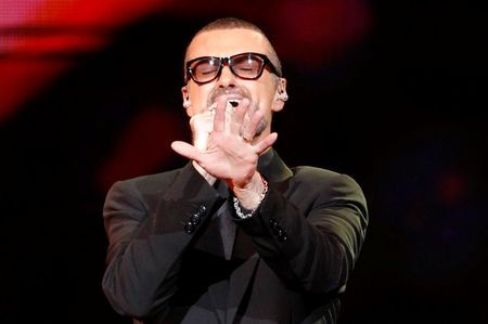 "FILE PHOTO British singer George Michael performs on stage during his ""Symphonica"" tour concert in Berlin September 5, 2011. REUTERS/Tobias Schwarz/File photo"