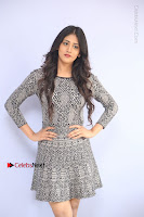 Actress Chandini Chowdary Pos in Short Dress at Howrah Bridge Movie Press Meet  0033.JPG