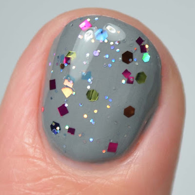 rainbow glitter nail polish close up swatch