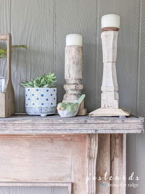 rustic mantel with blue and white planter and green stoneware bird